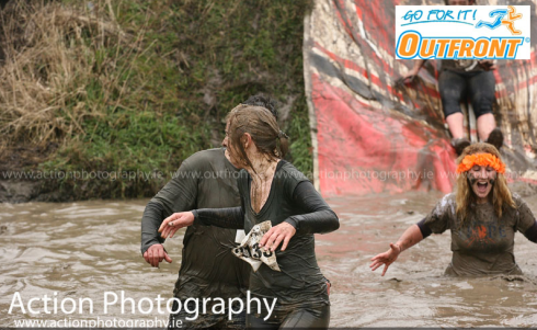 Piercing scream upon landing in the mud pit...so freaking cold! (Photo by Action Photography)